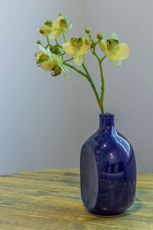 Blue vase on a wooden table in a modern interior interior. Archivio Fotografico - 134555573