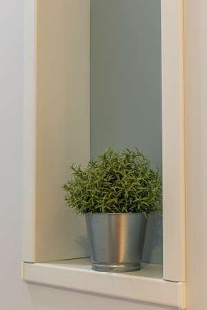 Small bucket with artificial grass in the interior. Archivio Fotografico - 134555576