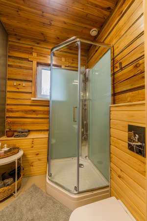 Modern interior of combined shower and toilet. Archivio Fotografico - 134555582