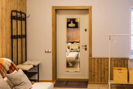 Beautiful modern entrance door with a mirror. Archivio Fotografico - 134555546