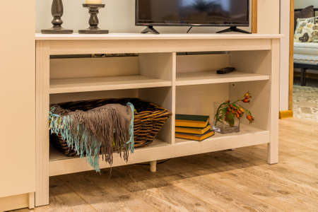 Wooden white TV stand in the interior of the house. Archivio Fotografico - 134555557