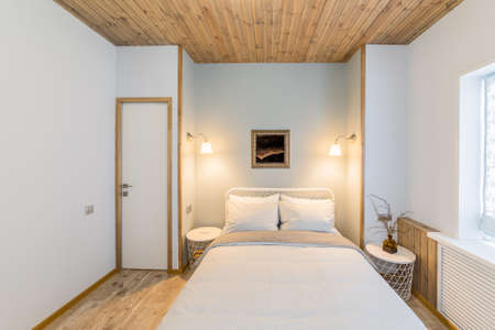 Luxurious stylish and cozy bedroom interior in the house. Archivio Fotografico - 134555566