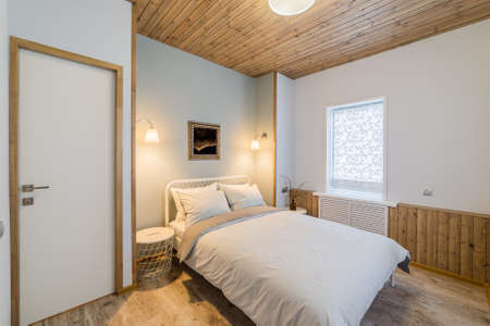 Luxurious stylish and cozy bedroom interior in the house. Archivio Fotografico - 134555567
