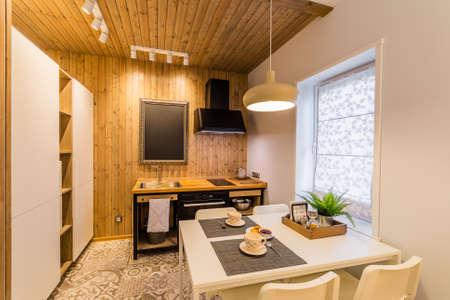 Beautiful modern kitchen interior in a studio house. Archivio Fotografico - 134555513