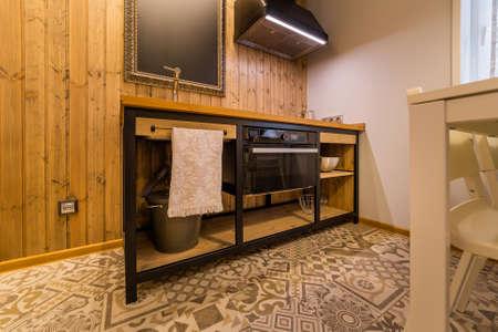 Beautiful modern kitchen interior in a studio house. Archivio Fotografico - 134555519
