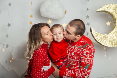 Beautiful happy family of three in a New Years decor. Happy Merry Christmas 2020. Archivio Fotografico - 134555466