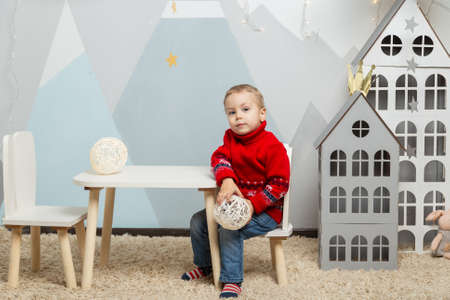 Beautiful happy boy in a New Years decor. Happy Merry Christmas 2020. Archivio Fotografico - 134555468
