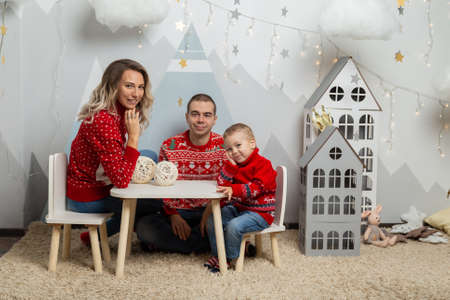 Beautiful happy family of three in a New Years decor. Happy Merry Christmas 2020. Archivio Fotografico - 134555470