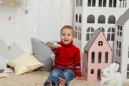 Beautiful happy boy in a New Year's decor. Happy Merry Christmas 2020 Archivio Fotografico - 134555392