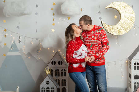 Beautiful happy couple in love in the Christmas decor for Christmas night. Happy Merry Christmas 2020. Archivio Fotografico - 134555400