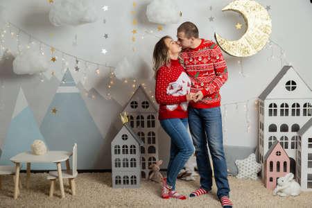 Beautiful happy couple in love in the Christmas decor for Christmas night. Happy Merry Christmas 2020. Archivio Fotografico - 134555401