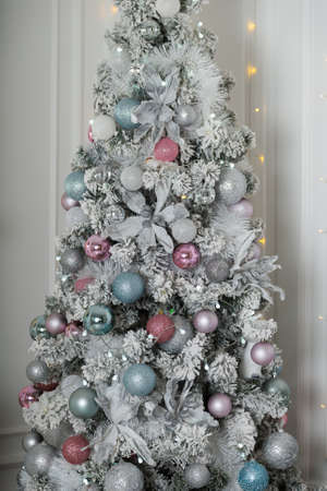 Elegant silver Christmas tree in a Christmas decor.