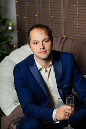 Handsome man with champagne in the new year 2020. Stock fotó