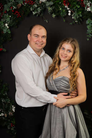 Happy couple with new year decor. Merry Christmas 2020. Archivio Fotografico - 135866805