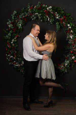 Happy couple with new year decor. Merry Christmas 2020. Archivio Fotografico - 135866812