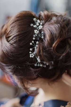 Very beautiful hairstyle with a diadem in the hair.