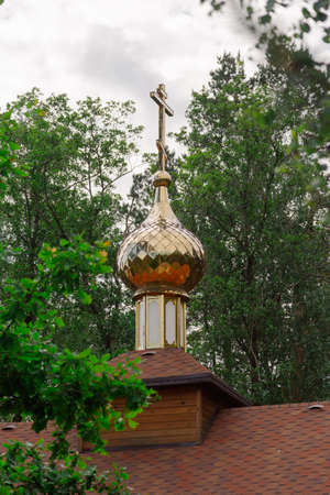 Golden dome of the church in clear weather.