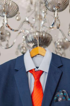 Stylish mens jacket hanging on a hanger. 版權商用圖片