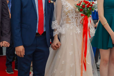Beautiful newlyweds at the solemn registration of marriage Imagens
