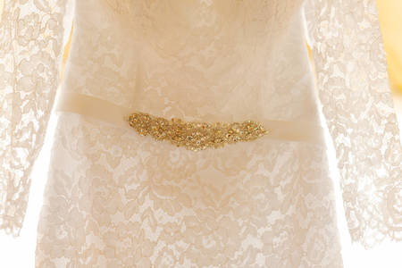 Beautiful wedding dress on a hanger on a happy wedding day. Imagens
