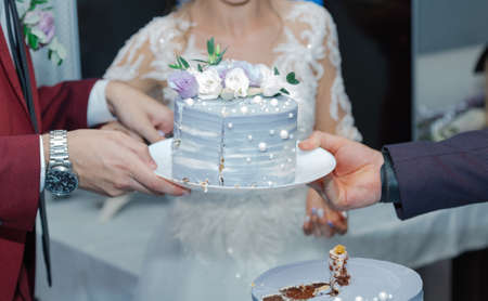 Beautiful wedding cake at a banquet on a happy wedding day.
