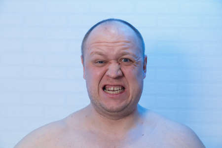 Portrait of a bald man who is angry. Standard-Bild