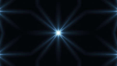 Beautiful lens flare with rays on a black background.