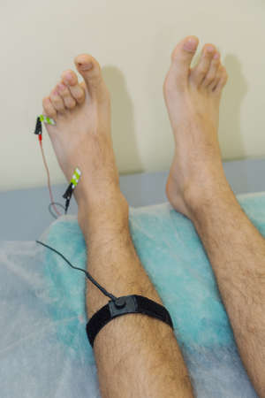 Man with sensors on his leg in the clinic.