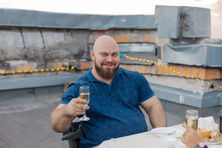 Handsome bearded man with glass of champagne.