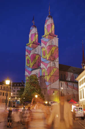 grossmunster cathedral: Grossmunster cathedral in Zurich, Switzerland in color overlay projection while Zurich City Festival 2010. Stock Photo