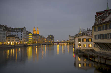 grossmunster cathedral: River Limmat with Grossmunster cathedral at dusk.