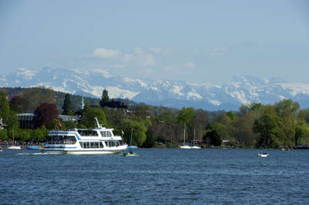 View over the right side of the lake of Zurich into the alps Stock Photo