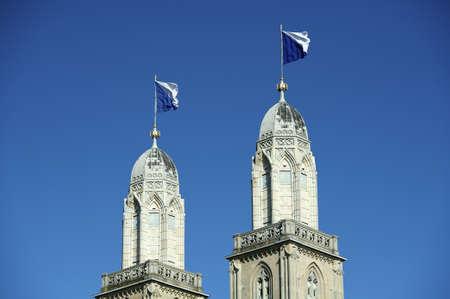 grossmunster cathedral: Grossmunster cathedral with flagged steeples, Zurich, Switzerland
