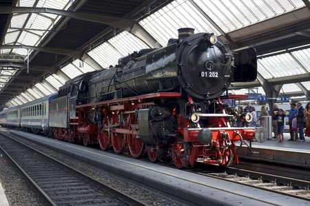 Zurich, Switzerland - June 4, 2011: A train with a refurbished Pacific 01 202 steam locomotive is ready to depart from Zurich main station (Hauptbahnhof).