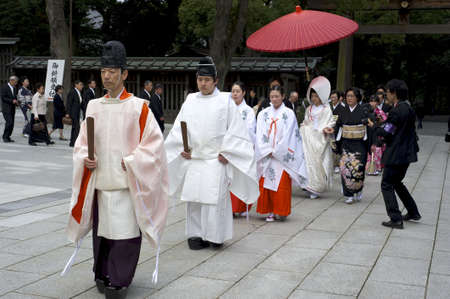 shrine: Tokyo, Japan - March 28, 2010: A shinto wedding ceremony at the famous Meiji shrine in Harajuku, Tokyo, Japan.