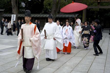 Tokyo, Japan - March 28, 2010: A shinto wedding ceremony at the famous Meiji shrine in Harajuku, Tokyo, Japan. Stock Photo - 9691035