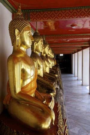 Buddha statues at Wat Po, Bangkok - Thailand Stock Photo - 13214741