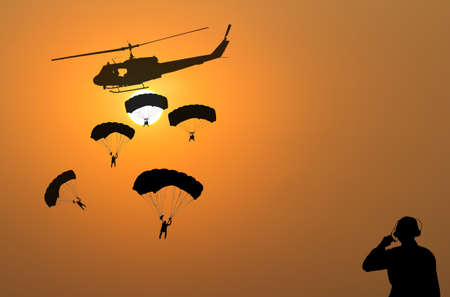 blackhawk helicopter: Parachuting exit from a helicopter at sunset.