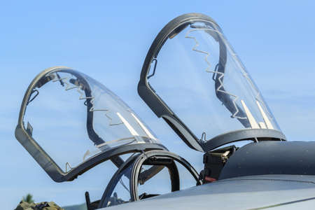 Closeup of aircraft canopy against a blue sky Stock Photo