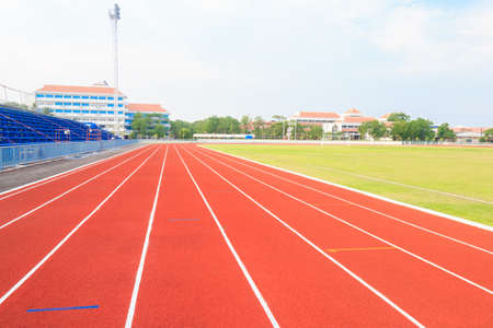Running track ,Green lawn and blue sky.
