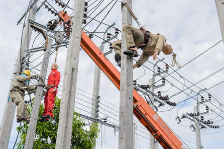 Outdoor activities demonstration of pole top rescue. Plastic simulation to perform the high-voltage distribution system,Electrician electrocuted by practicing on a light pole,