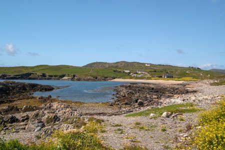 Hidden cove on Mizen Head peninsula with a small sandy beach.County Cork,Ireland.