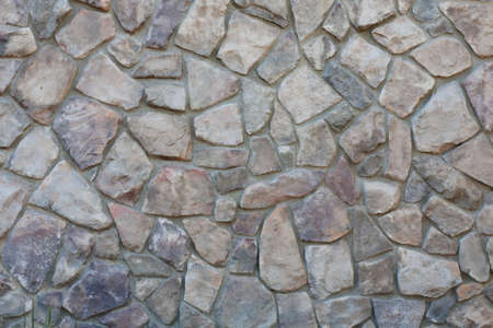 A wall made of rocks and stones.