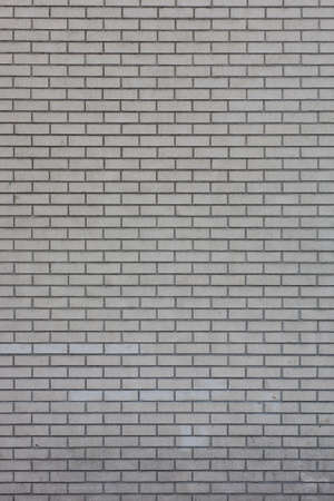 A background of many gray, uniform bricks.