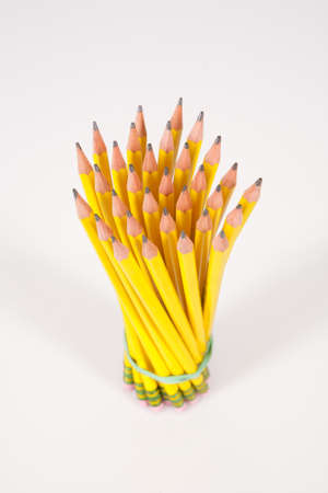 A bouquet  bunch of yellow, #2 pencils set against a white background.