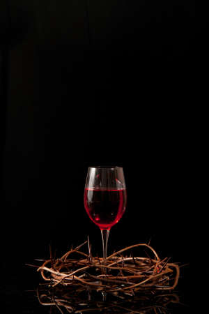 Communion wine in a crown made of thorns photo