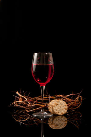 Communion wine, crackers, and a crown of thorns photo
