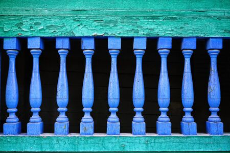 Classic old-fashioned green balustrade with blue weathered balusters.
