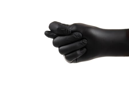 Male hand in a black disposable glove showing a fig sign. Side view, isolated on white.