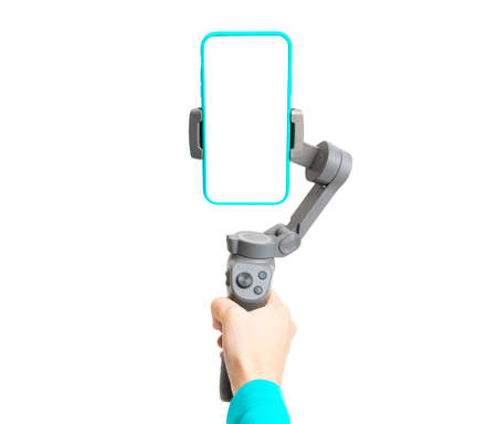 3-axis phone gimbal stabilizer in woman's hand isolated on white background. Banque d'images